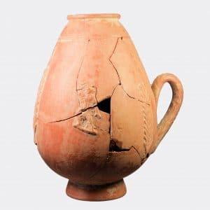 Roman Antiquities - Roman pottery flask with reveller figures