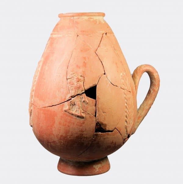 Roman Antiquities - Roman pottery flask with reveller figures