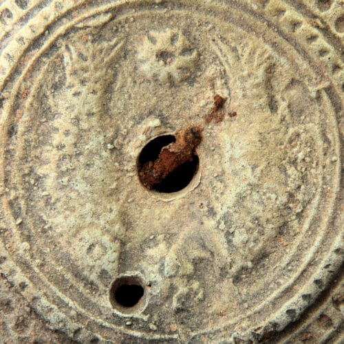 Roman Antiquities - Roman oil lamp decorated with two fish