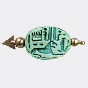 Egyptian Antiquities - Egyptian scarab depicting Khnum below Amun and Ra inscriptions