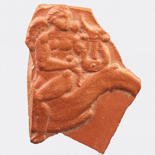 Roman Antiquities - Roman fragment depicting a nereid riding Triton