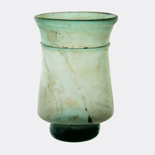 Roman Antiquities - Byzantine or Coptic glass cup with a solid pad foot