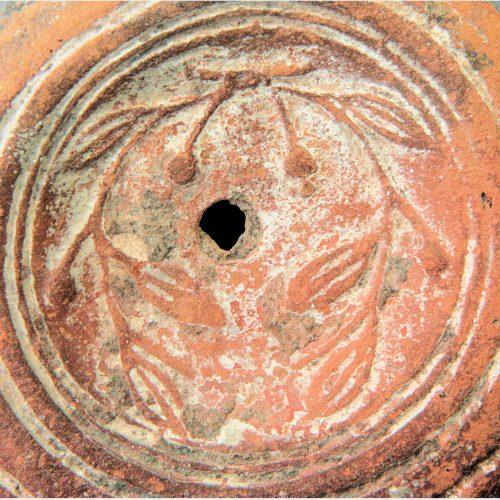 Roman Antiquities - Roman oil lamp with mistletoe decoration