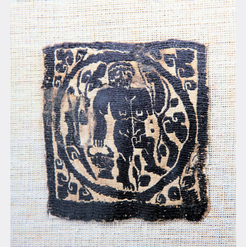 Miscellaneous Antiquities - Egyptian Coptic textile with grape harvesting scene
