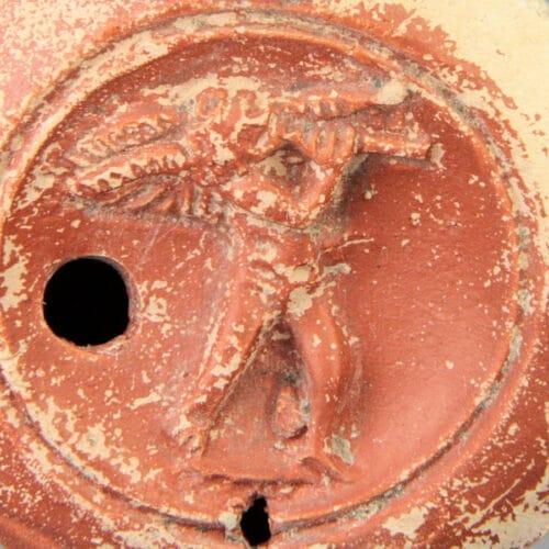 Roman Antiquities - Roman erote oil lamp by Caius Oppius Restitutus