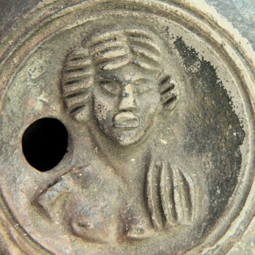Roman Antiquities - Roman lamp with female bust, made by Marcus Novius Iustus