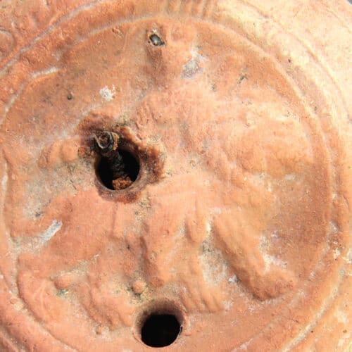 Roman Antiquities - Roman oil lamp depicting Cybele riding a lion